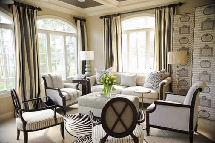 Small living room with curtains hung at the ceiling - Photo by Erika Bonnell Interiors