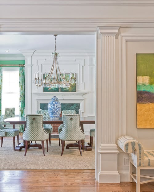 Eclectic dining room with faux columns