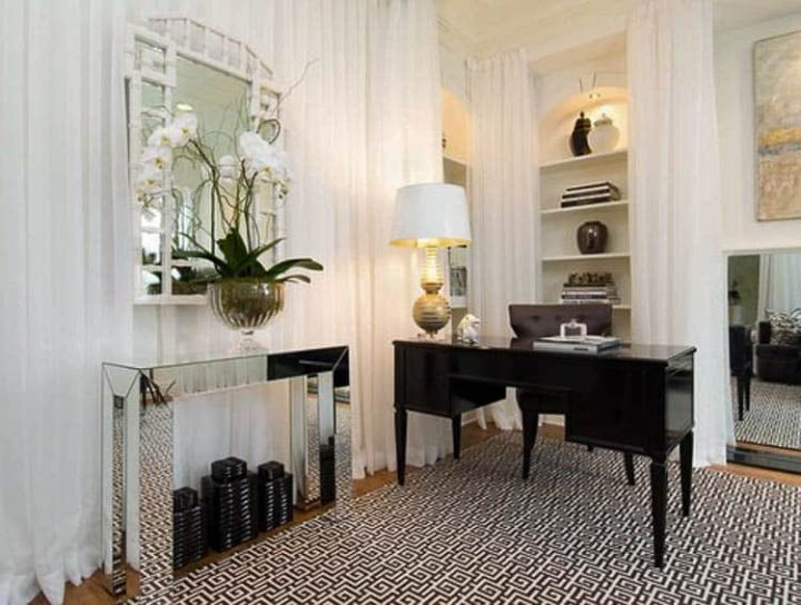 A large area rug in a home office - Photo by Tiffany Eastman Interiors, LLC