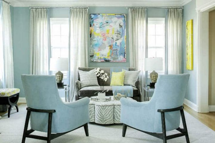 Small living room with large piece of artwork- Photo by Karen B Wolf Interiors, Associate ASID