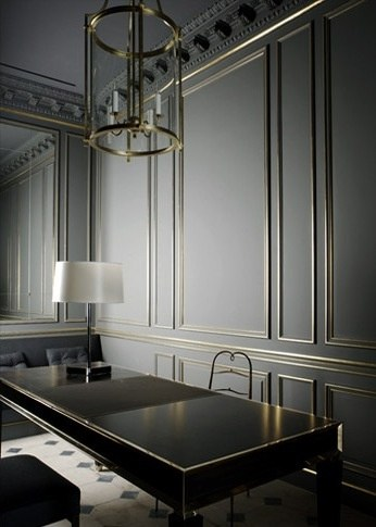 Gold panel moldings on a gray wall. Photo by via mydomaine.com