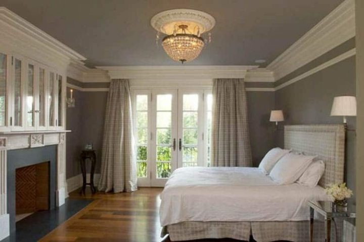 Gray and white bedroom with crown moldings