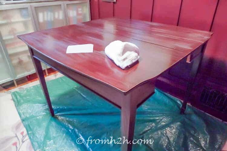 Sand the table with fine grain sand paper and wash clean | Urban table makeover using metallic paint