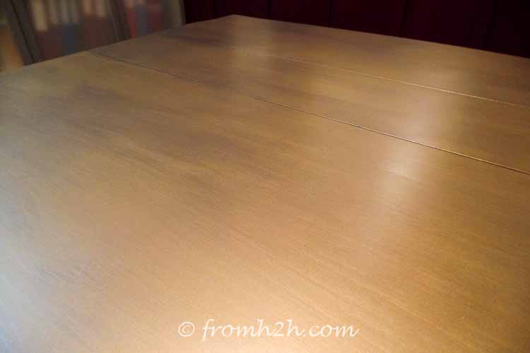 Adding the Gun Metal darkens the brass finish | Urban table makeover using metallic paint