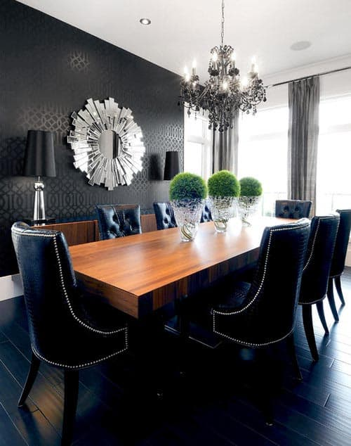 A large chandelier over the table adds glamour and light | 7 Tips for Decorating a Black Room (so that it doesn't look like a cave)