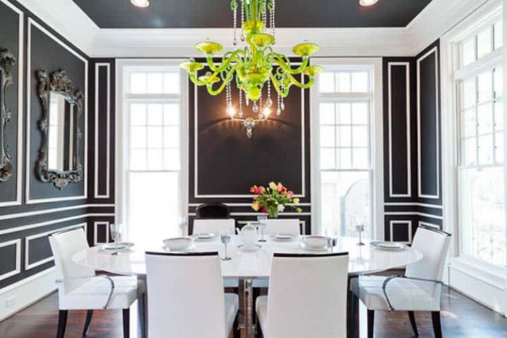 Black and white dining room with a neon green chandelier