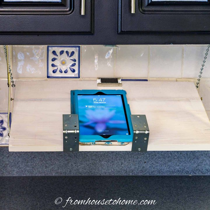 The DIY under cabinet cookbook shelf holding an iPad mini
