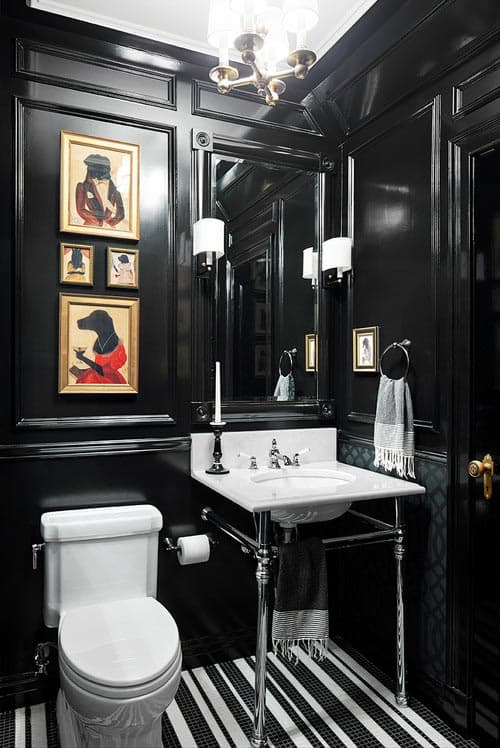 The shine from the black lacquer paint in this bathroom reflects some light back into the room | 7 Tips for Decorating a Black Room (so that it doesn't look like a cave)