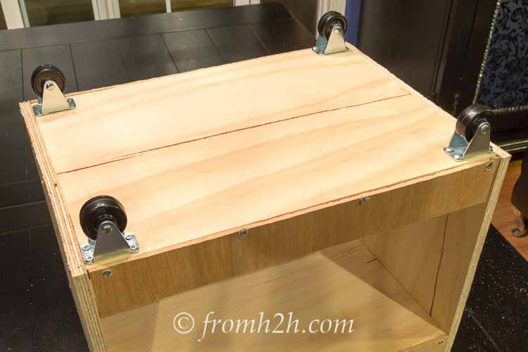 Add casters to the bottom of the pull out drawer