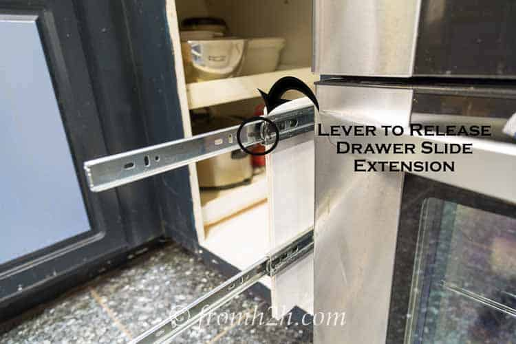 Remove the slide extension by pushing on the release lever and pulling out on the extension