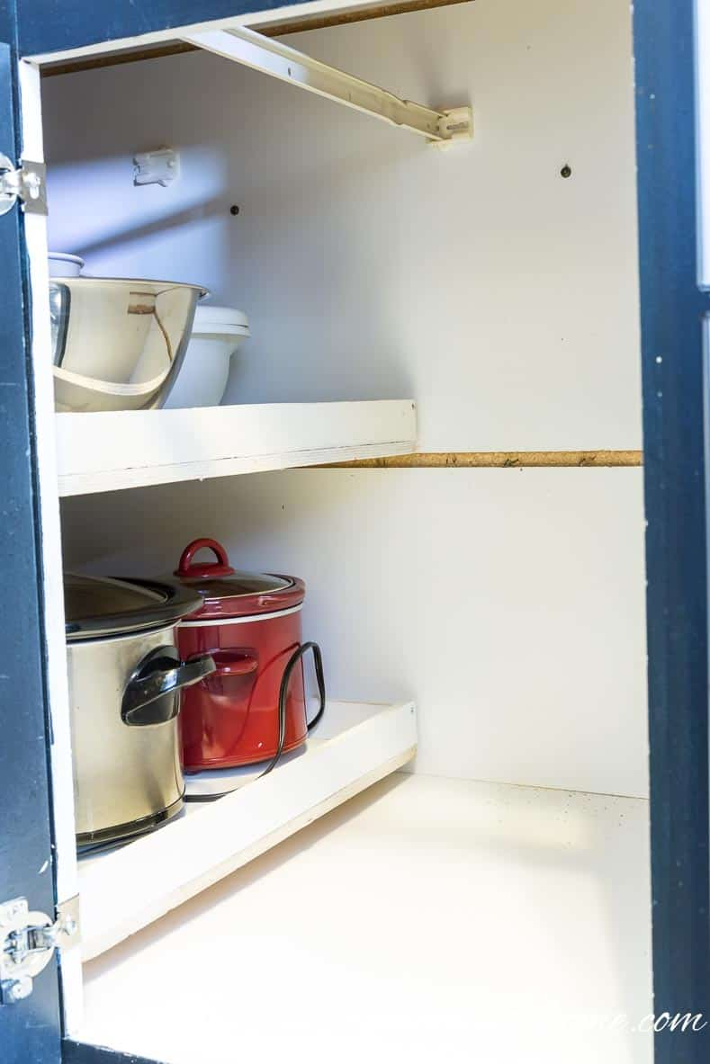 The shelves pushed back into the cabinet | How To Build Blind Corner Cabinet Pull Out Shelves