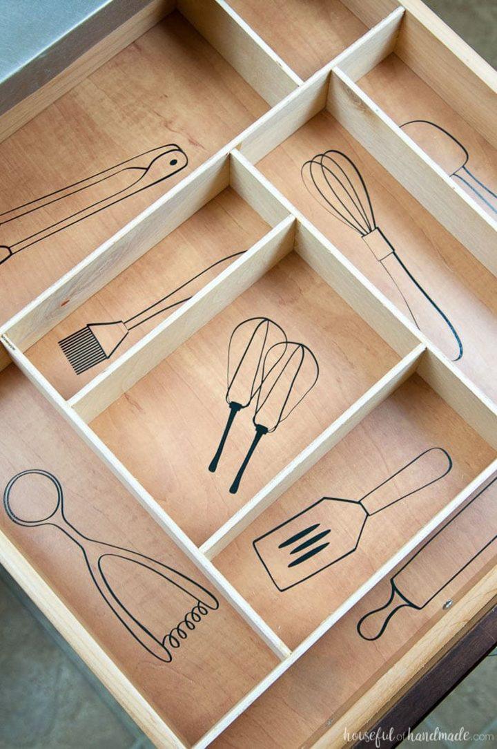 Kitchen drawer organizer with utensil drawings via housefulofhandmade.com