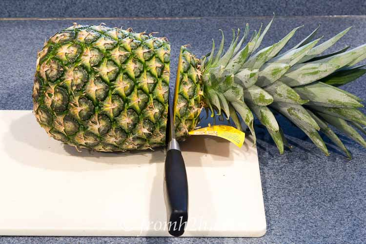 Cut the top off of the pineapple | Inexpensive Kitchen Gadgets That Make Cooking Easier