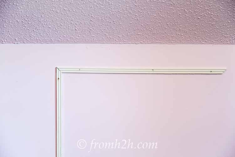 Put in three or four nails to hold the second board in place | How To Add Architectural Interest with DIY Panel Mouldings