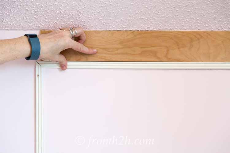 Use the spacer to make sure that the next board is even | How To Add Architectural Interest with DIY Panel Mouldings