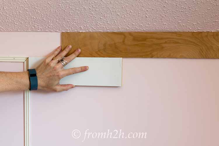 Create spacers out of scrap wood | How To Add Architectural Interest with DIY Panel Mouldings
