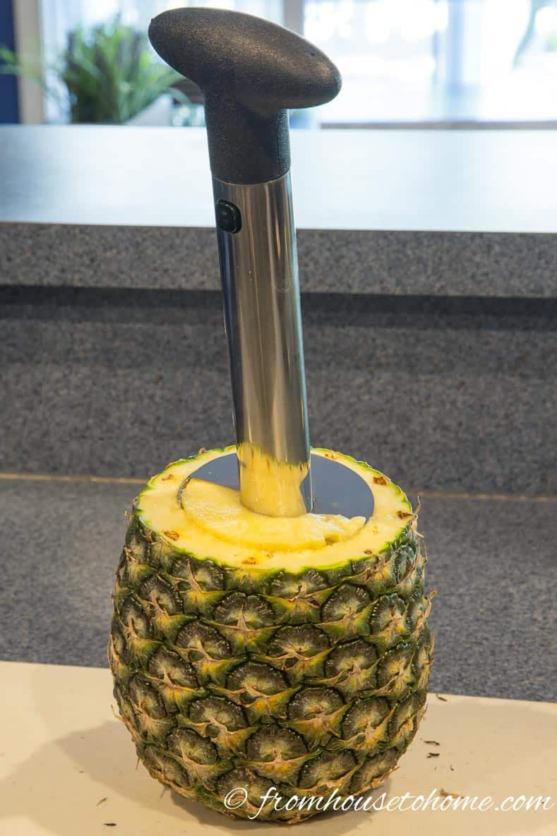 Position the pineapple cutter so that it is over the pineapple core | Inexpensive Kitchen Gadgets That Make Cooking Easier