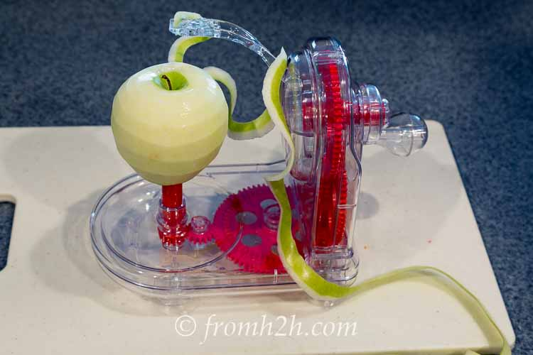 Rotate the handle until the apple is peeled | Inexpensive Kitchen Gadgets That Make Cooking Easier