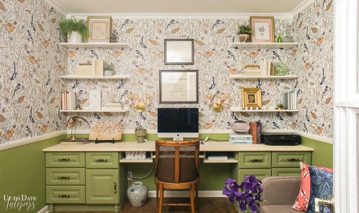 Green desk in a glam home office with birds on the wallpaper