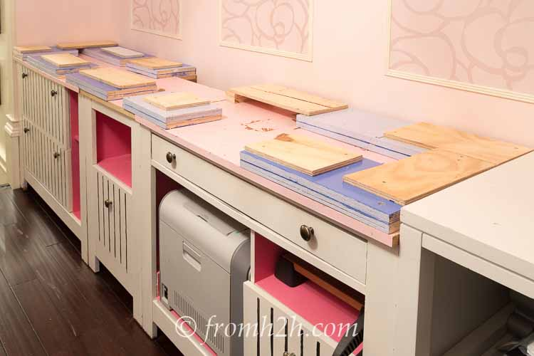 Add spacers to the lower cabinets | How To Create Built Ins From Mismatched Furniture