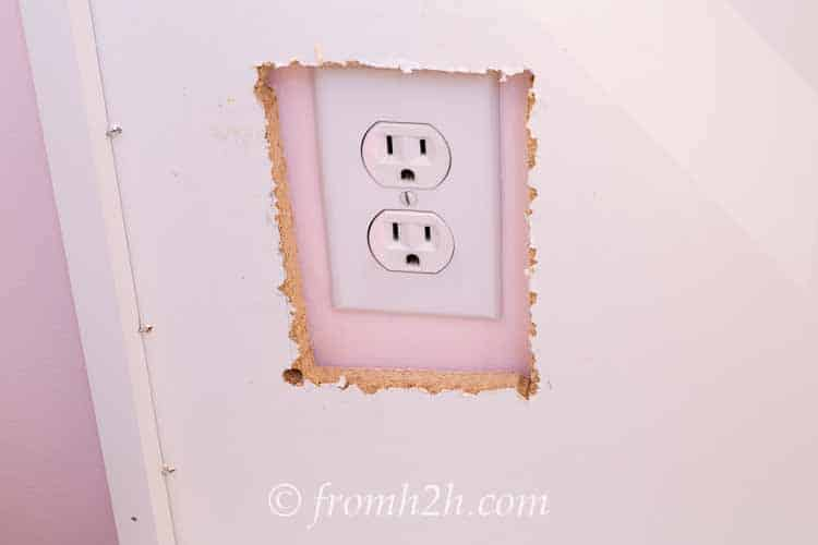 Make sure the electrical outlet can be seen through the hole | How To Create Built Ins From Mismatched Furniture