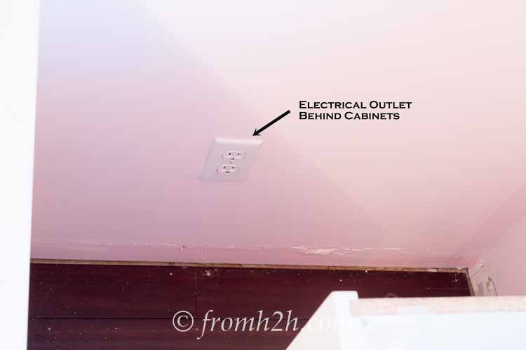 Look for outlets behind the cabinets | How To Create Built Ins From Mismatched Furniture
