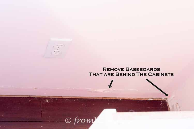 Remove baseboards that are behind the cabinets | DIY Bonus Room Bookshelves And Window Bench
