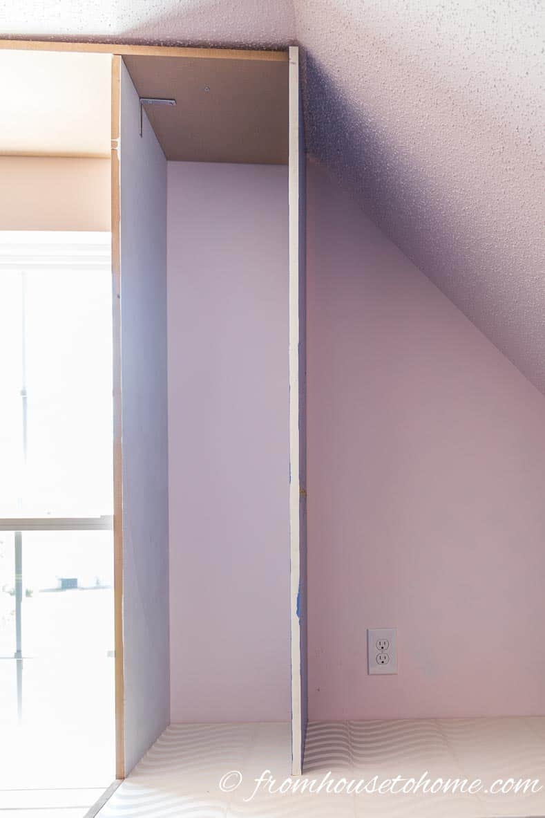 Install the second vertical support panel | DIY Bonus Room Bookshelves And Window Bench