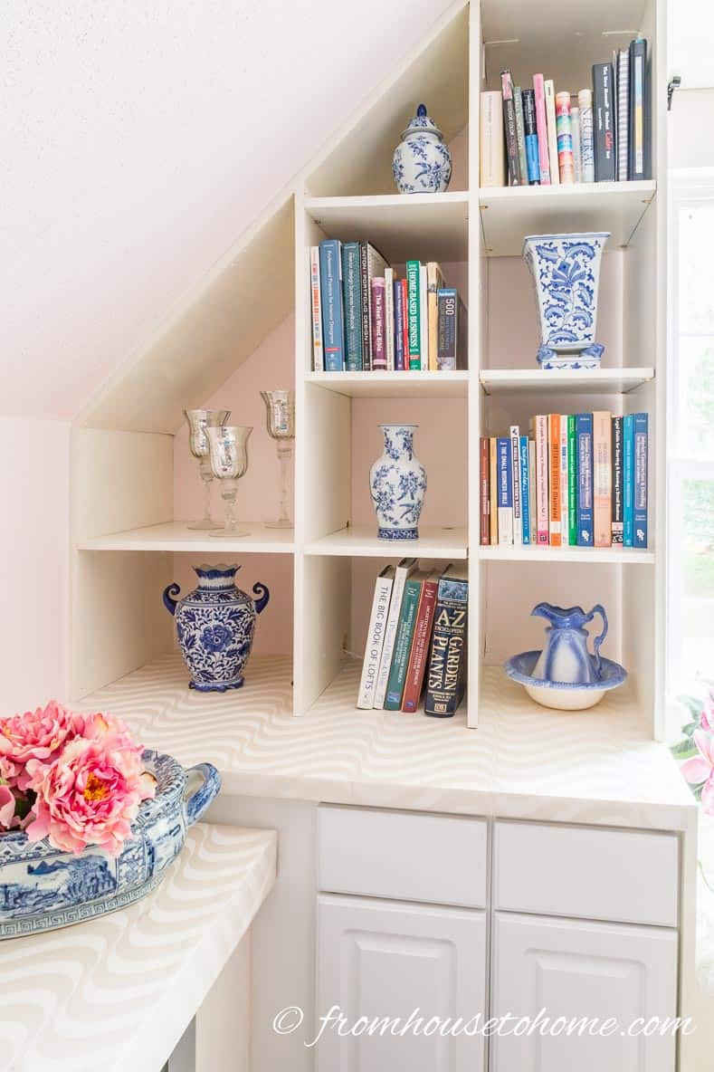 The bonus room shelves | DIY Bonus Room Bookshelves And Window Bench
