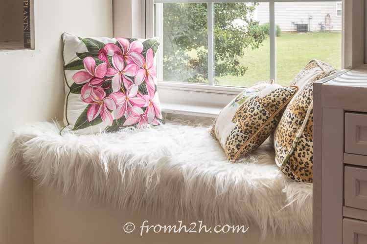 Add cushions to your window bench | DIY Bonus Room Bookshelves And Window Bench