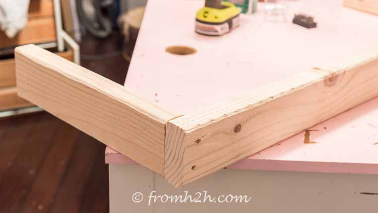Build a frame for the window bench with the short boards butting up to the longer boards | DIY Bonus Room Bookshelves And Window Bench