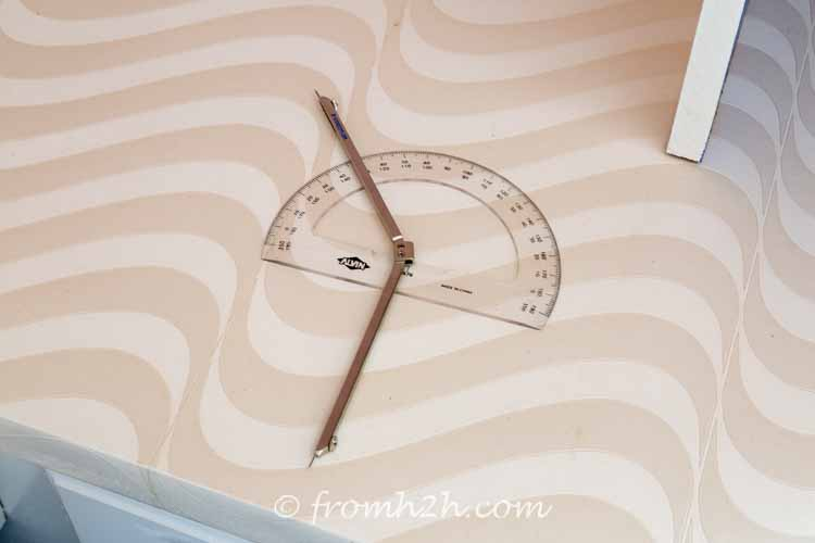 Use a protractor to measure the angle | DIY Bonus Room Bookshelves And Window Bench