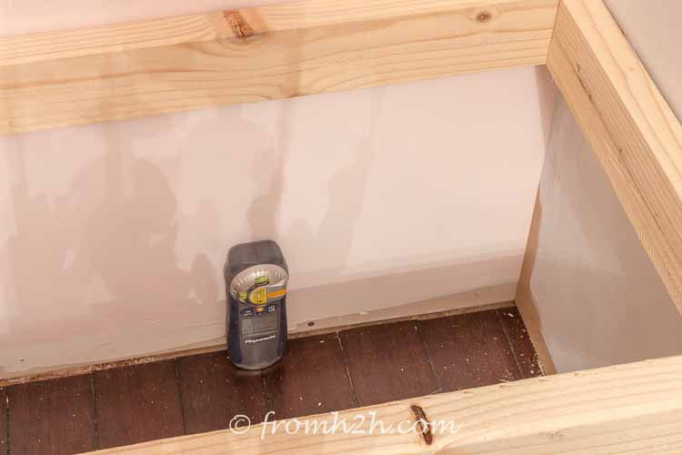 Use a stud finder to find where the screws should go | DIY Bonus Room Bookshelves And Window Bench