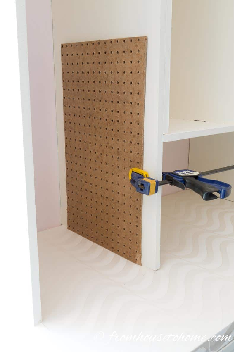 Use pegboard as a template for drilling shelf support holes