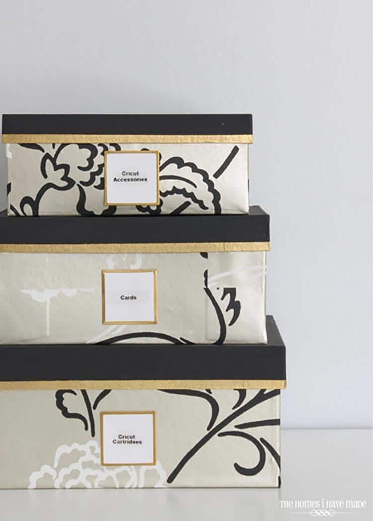 Wallpaper-covered storage boxes, via forreent.com