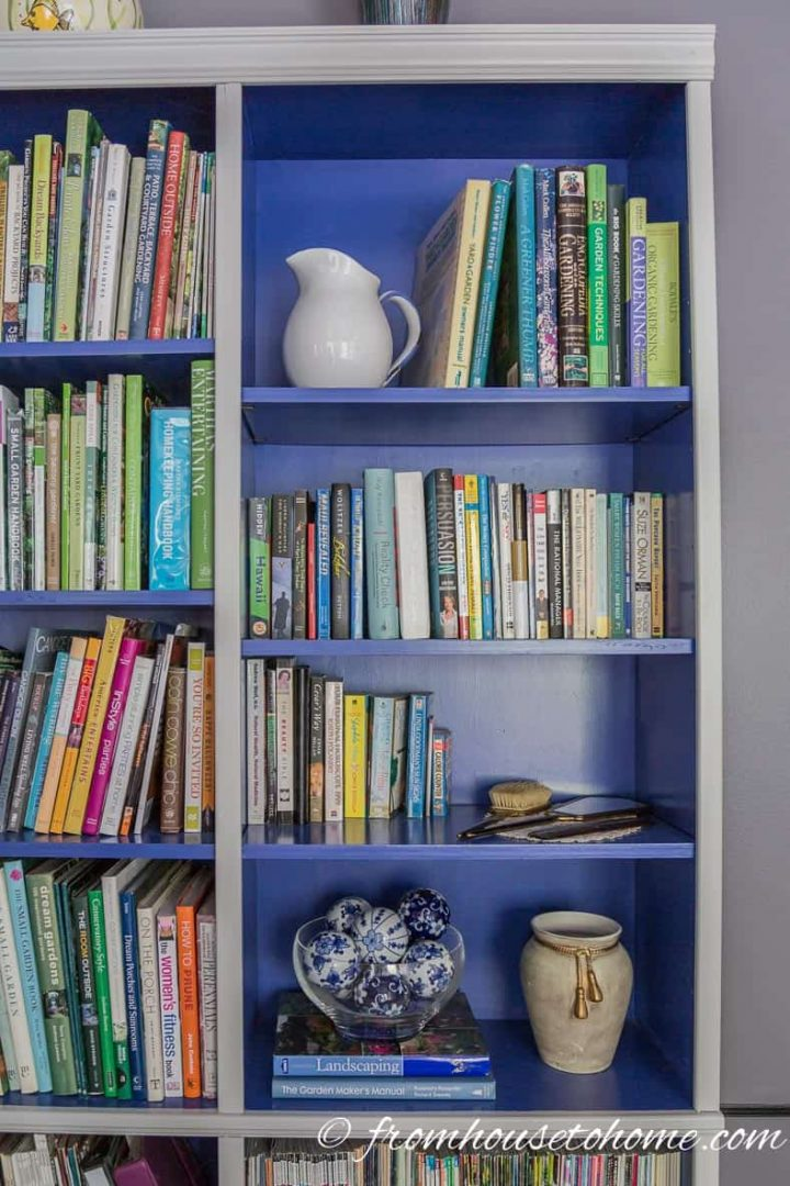 Bookcase with the outside painted gray and the inside painted blue