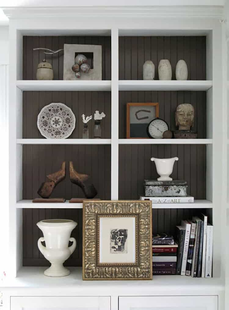 Beadboard adds texture to the back of a bookshelf, via anurbancottage.blogspot.com | 7 Simple Ways To Dress Up Your Bookshelves