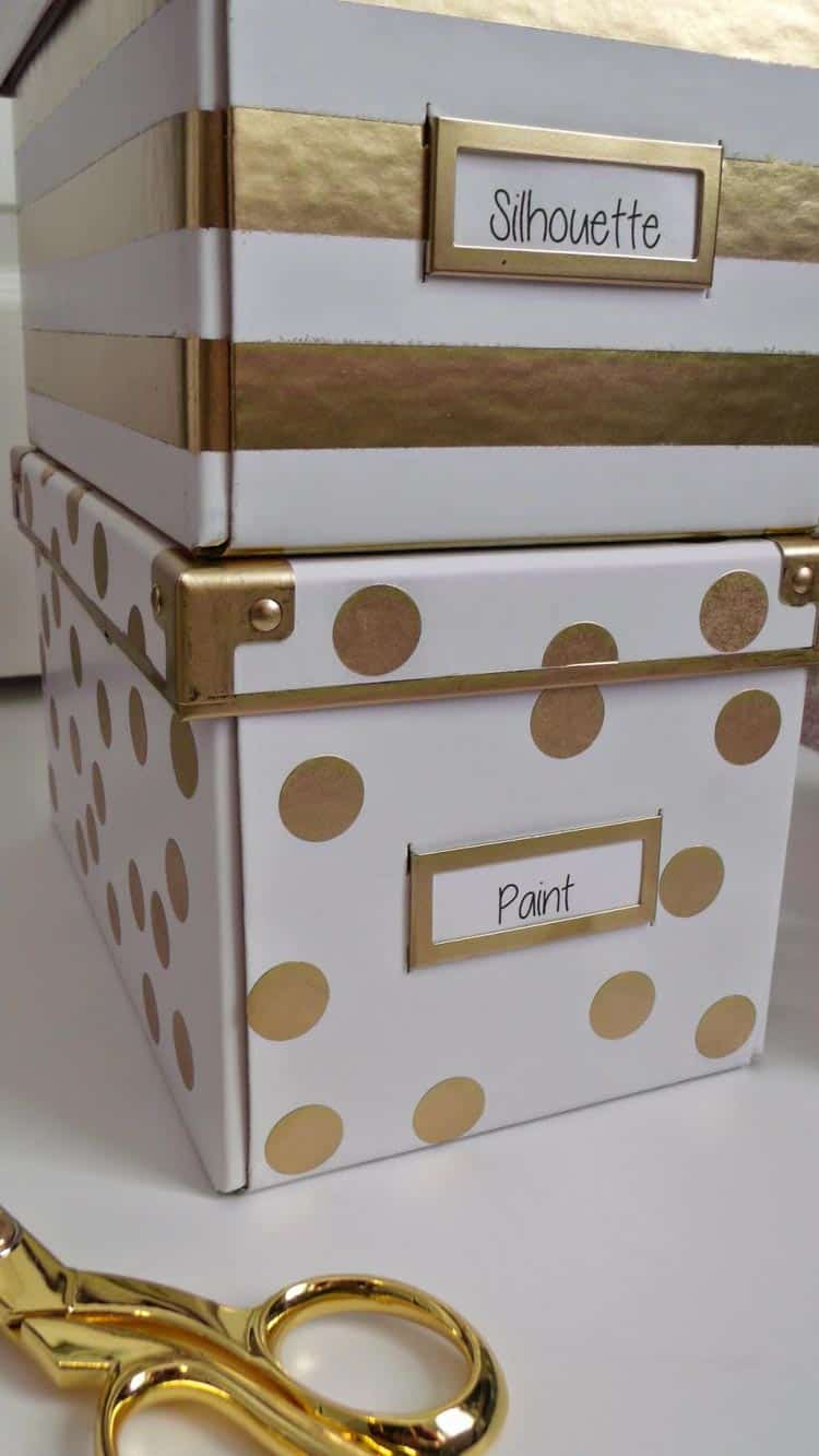 White storage boxes painted with gold stripes and polka dots, via littlebitsoflacey.blogspot.com