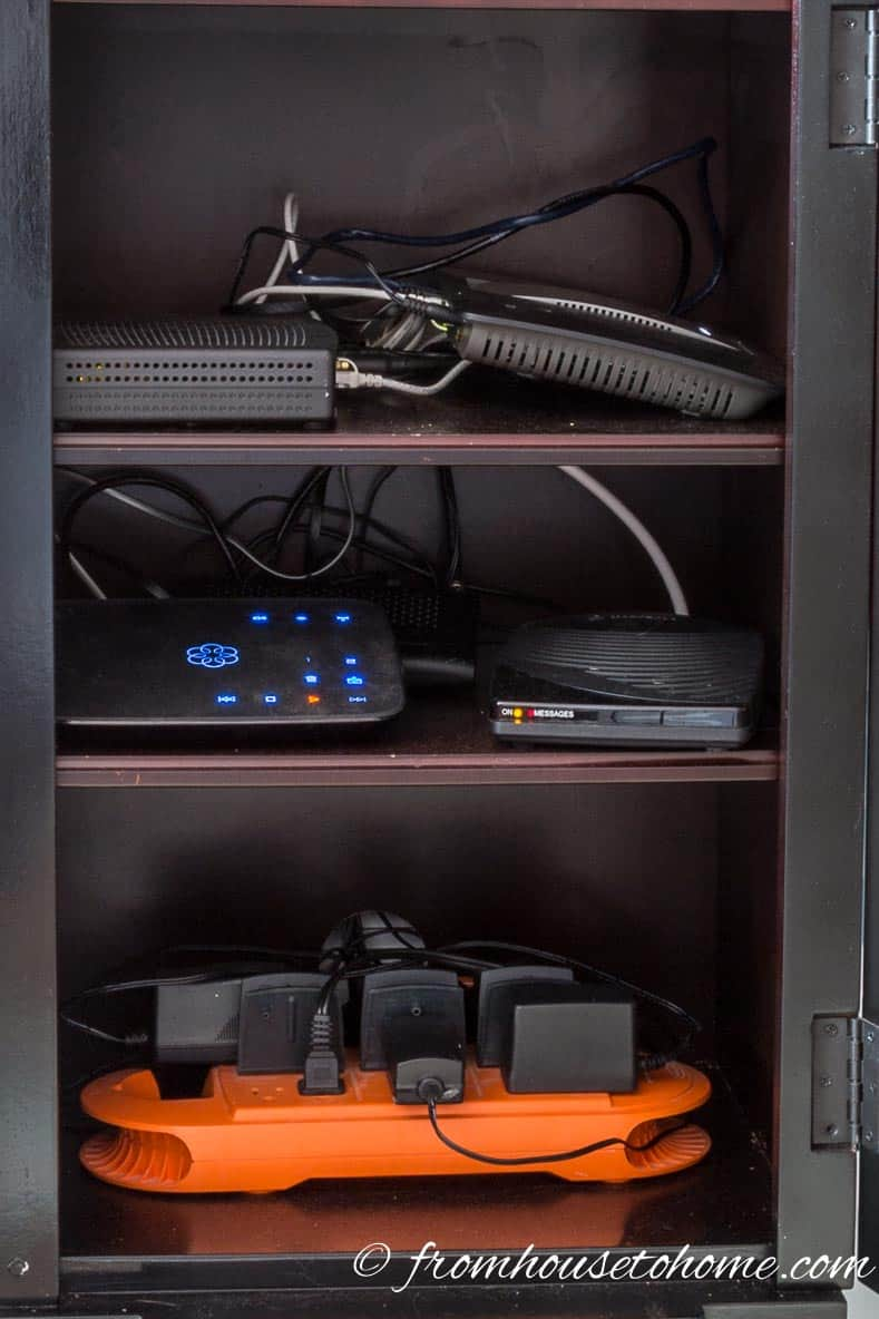 The electronics stored inside the cabinet | How To Hide Your Router and Modem