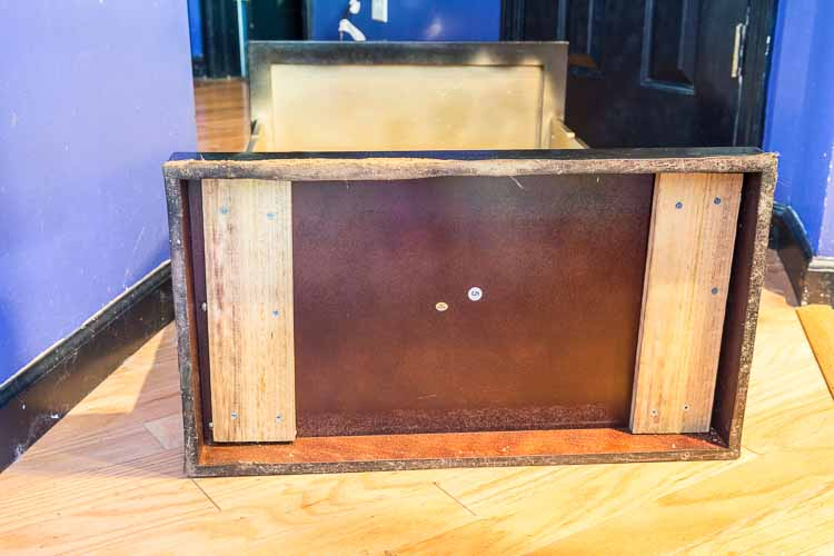 Attach boards to the bottom of the bar | DIY Hollywood Regency Bar Cabinet Makeover