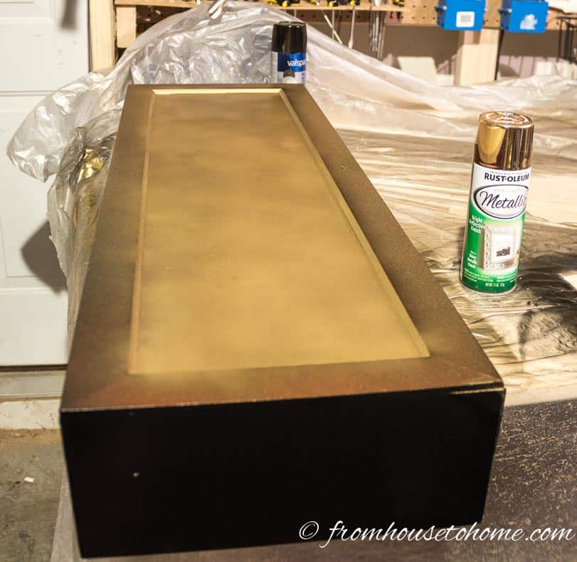 Spray paint the inside gold | DIY Hollywood Regency Bar Cabinet Makeover