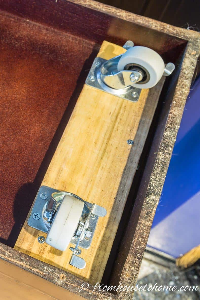 Attach casters to the boards | DIY Hollywood Regency Bar Cabinet Makeover