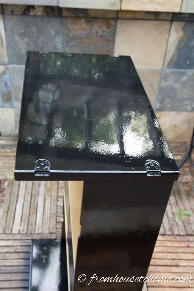 Spray the black lacquer outside to keep from breathing too many fumes | DIY Hollywood Regency Bar Cabinet Makeover