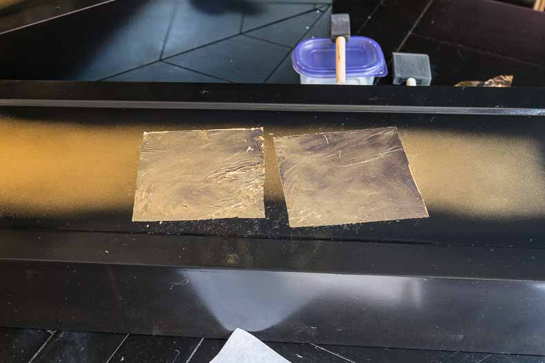Gold foil sheets stuck to furniture