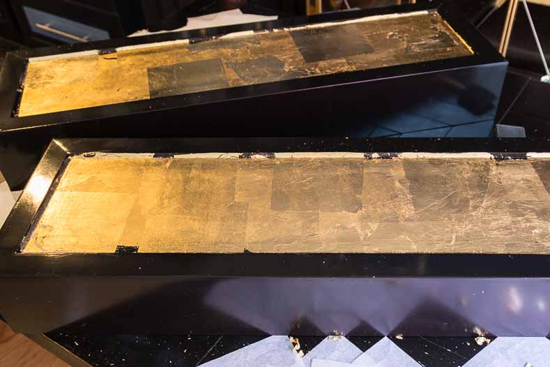 Cabinet doors with gold leaf applied to the front