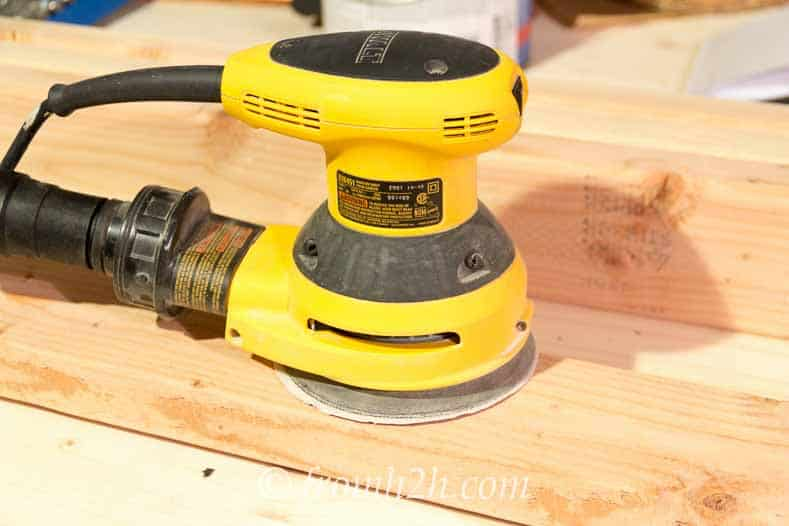 Use a rotary sander to smooth out the boards