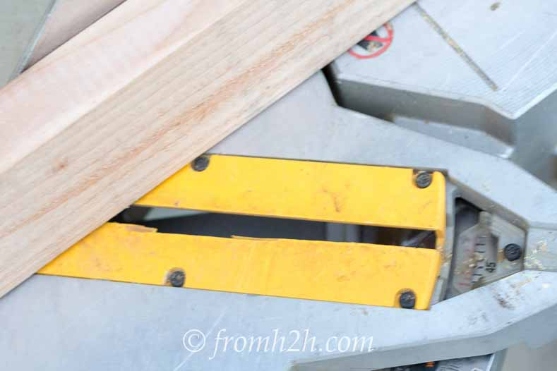 Stand the boards on edge and cut them at a 45 degree angle