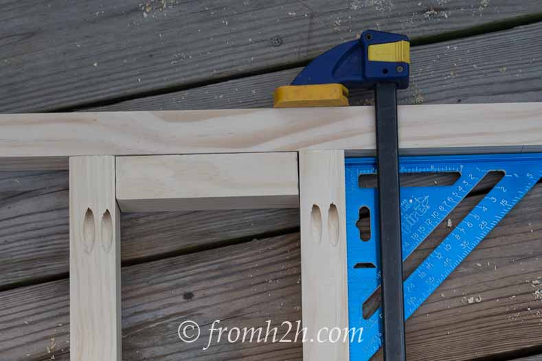 Use a spacer to figure out where to put the next rung | DIY Fabric Storage Ladder