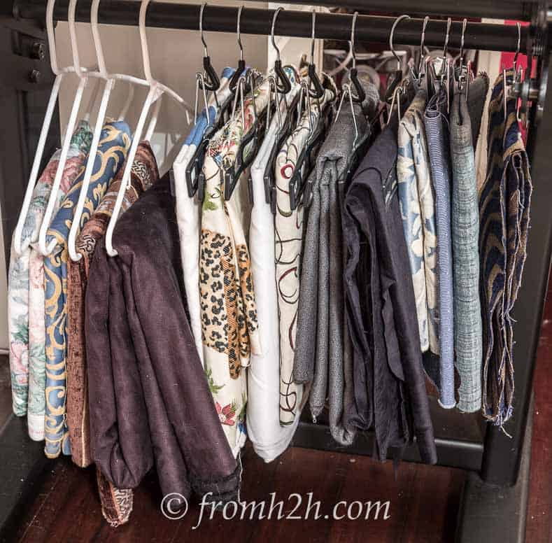 Hanging fabric from regular hangers or skirt hangers is another option | DIY Fabric Storage Ladder