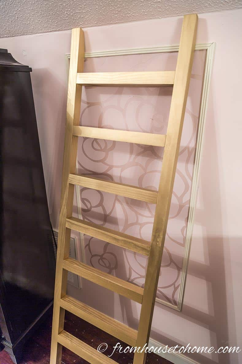 Lean the ladder up against the wall | DIY Fabric Storage Ladder